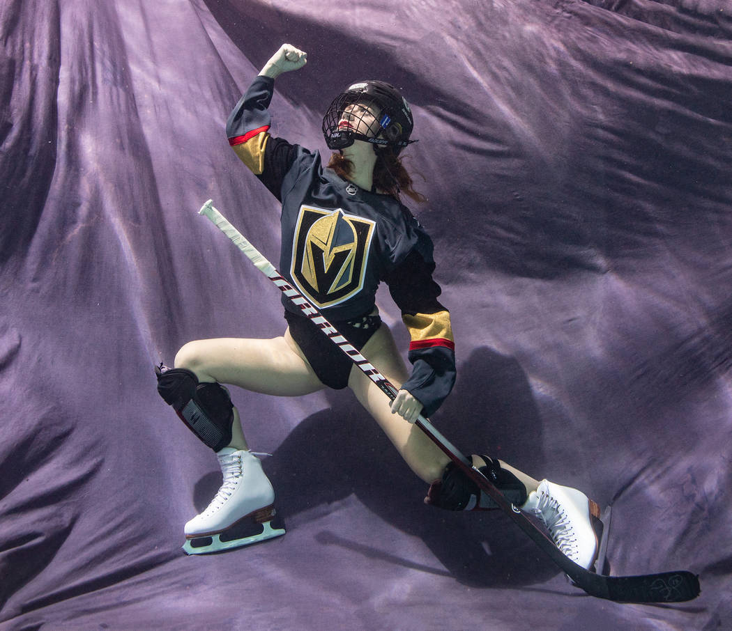 USA national youth team coach of synchronized swimming and head coach of the Nevada Desert Mermaids, Ludivine Perrin-Stsepaniuk, poses underwater with her Vegas Golden Knights jersey. Tomasz Rossa ...
