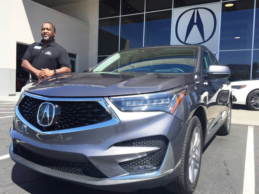 Findlay Findlay Acura sales consultant John Williams shows off the 2019 Acura RDX at the dealership situated in the Valley Automall.