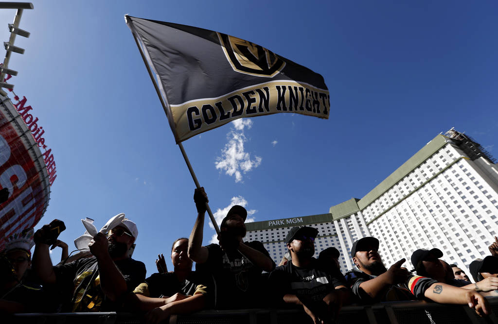 Fans gather outside T-Mobile Arena prior to Game 1 of the NHL hockey Stanley Cup Finals between the Vegas Golden Knights and the Washington Capitals, Monday, May 28, 2018, in Las Vegas. (AP Photo/ ...
