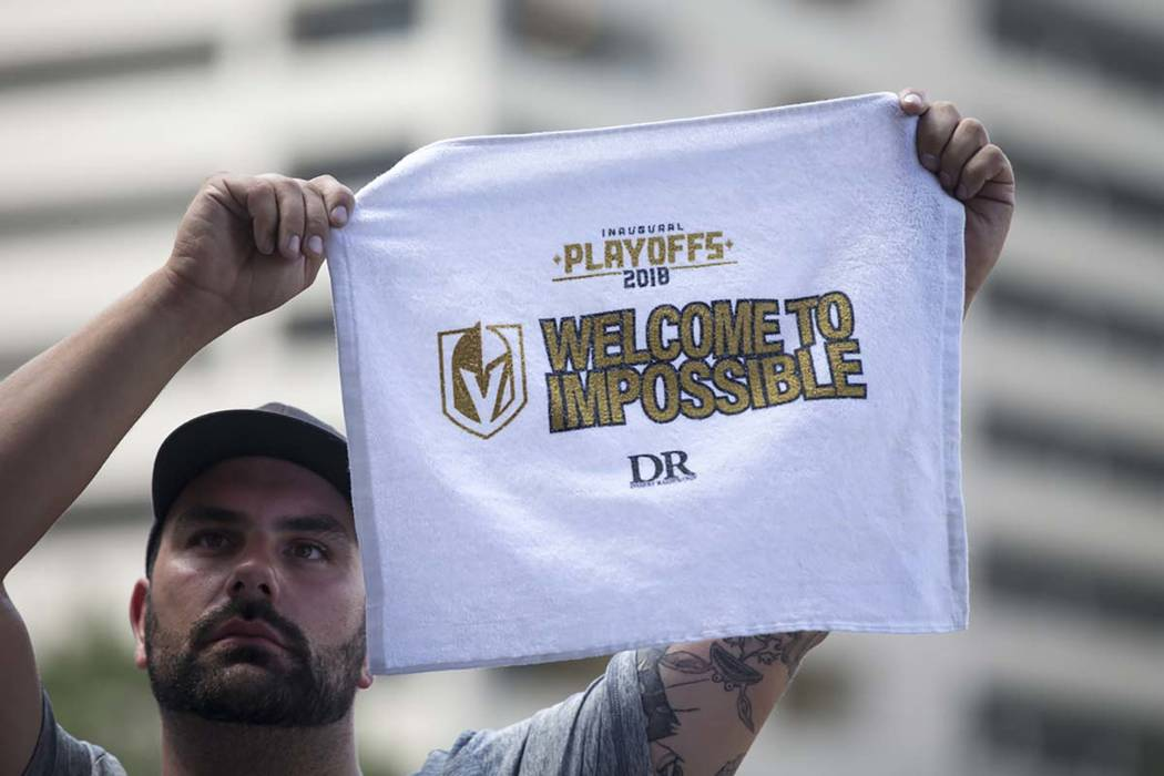 A Golden Knights fan holds up his battle towel during a watch party for Game 5 of the Western Conference Finals between the Golden Knights and the Winnipeg Jets at Toshiba Plaza in Las Vegas on Su ...