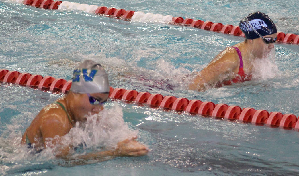 Green Valley's Rain Gavino, bottom, competes in the 100 breaststroke during the Class 4A state championships on Saturday, May 19, 2018 at UNLV. Gavino won the event in 1:04.91. (Tim Guesman/Las V ...