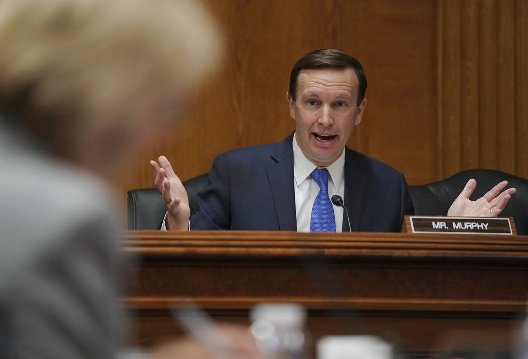 Senate Subcommittee on Labor, Health and Human Services, Education, and Related Agencies Appropriations member Sen. Chris Murphy, D-Conn., questions Education Secretary Betsy DeVos, left, during a ...