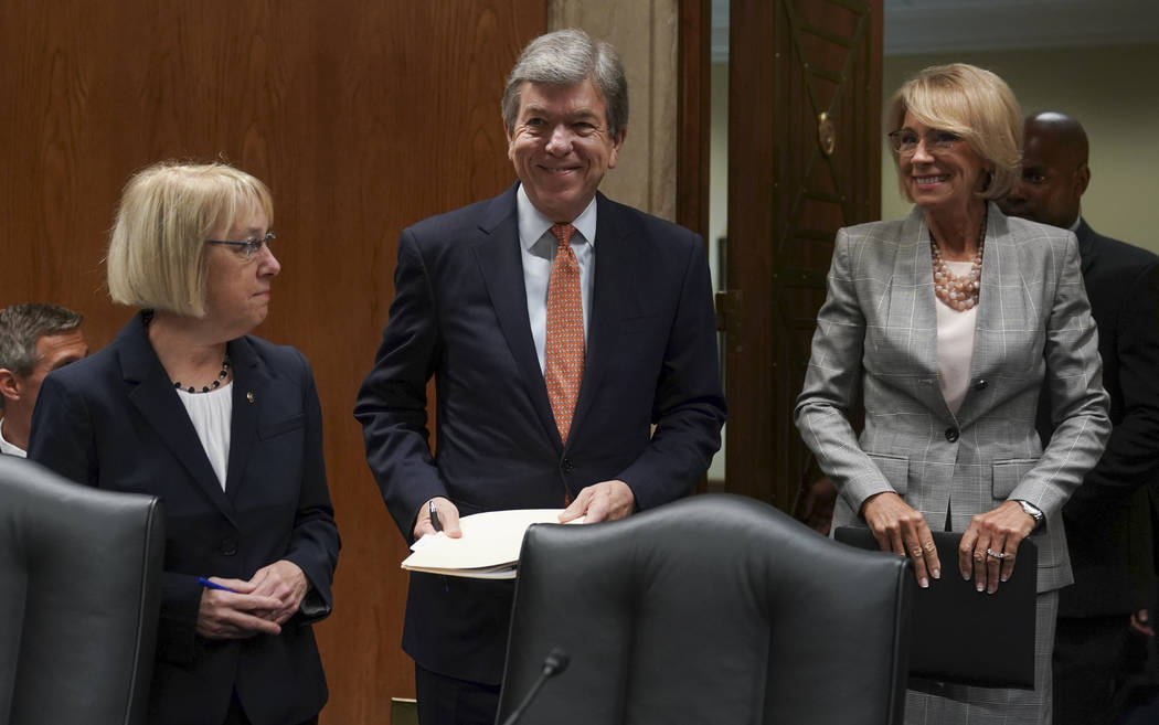 Education Secretary Betsy DeVos, right, Senate Subcommittee on Labor, Health and Human Services, Education, and Related Agencies Appropriations chairman Sen. Roy Blunt, R-Mo., center, and ranking ...