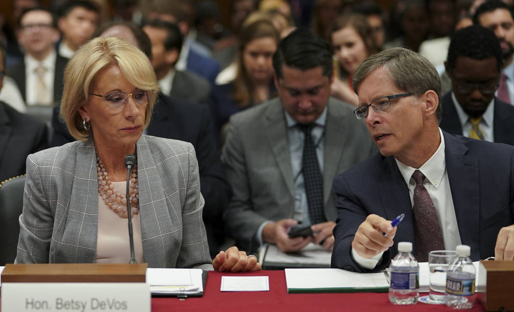 Education Secretary Betsy DeVos, left, and Bill Cordes of the Department of Education Budget Service, talk before the start of a Senate Subcommittee on Labor, Health and Human Services, Education, ...