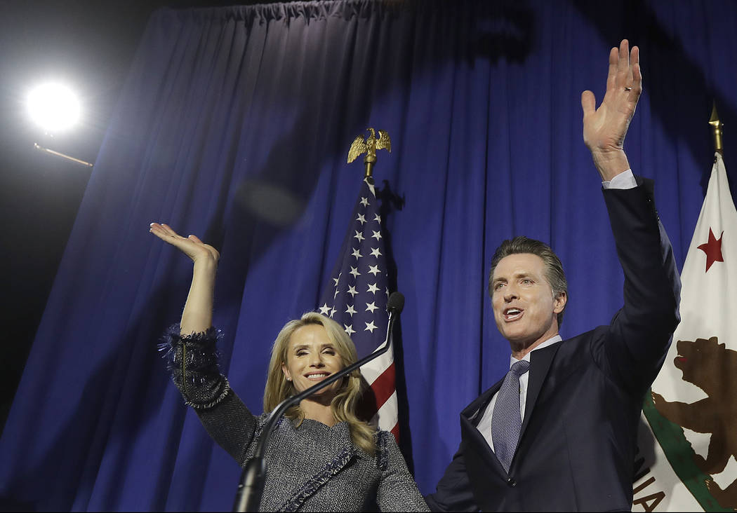 Democratic Lt. Gov. Gavin Newsom, right, waves with his wife JenniferSiebel Newsom after speaking at his gubernatorial campaign's primary night watch party in San Francisco, Tuesday, June 5, ...