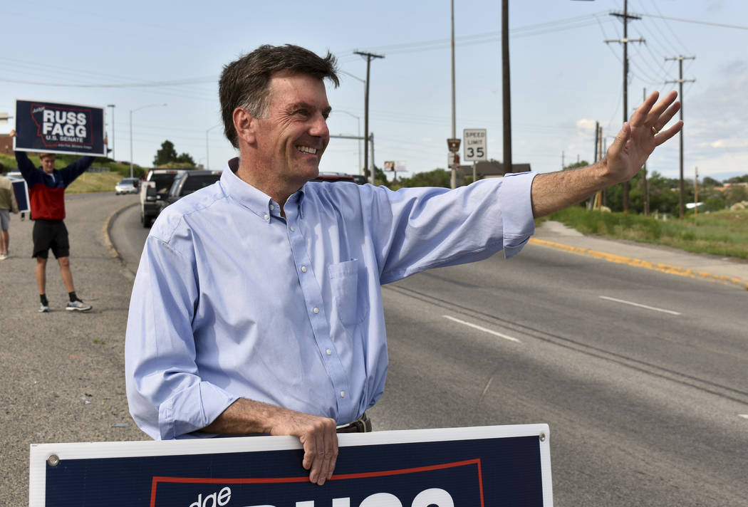 Retired state judge Russ Fagg, a candidate in Montana's Republican U.S. Senate primary, waves to drivers in a highway median, Tuesday, June 5, 2018 in Billings, Mont. Fagg says he was outspent by ...