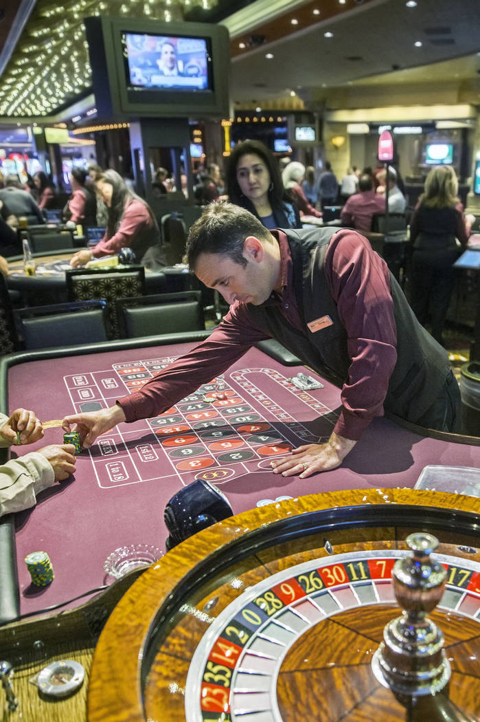 Roulette dealer Derek Hoffman, middle, places bets at the MGM Grand hotel-casino on Thursday, April 19, 2018, in Las Vegas. Benjamin Hager Las Vegas Review-Journal @benjaminhphoto