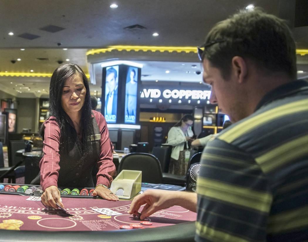 Table games dealer Dee Coffey, left, deals blackjack at the MGM Grand hotel-casino on Thursday, April 19, 2018, in Las Vegas. Benjamin Hager Las Vegas Review-Journal @benjaminhphoto