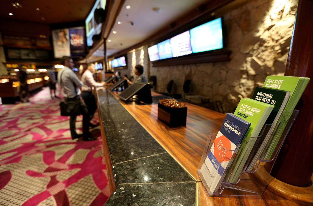 Problem gambling brochures on display at The Mirage sportsbook Thursday, June 7, 2018. K.M. Cannon Las Vegas Review-Journal @KMCannonPhoto