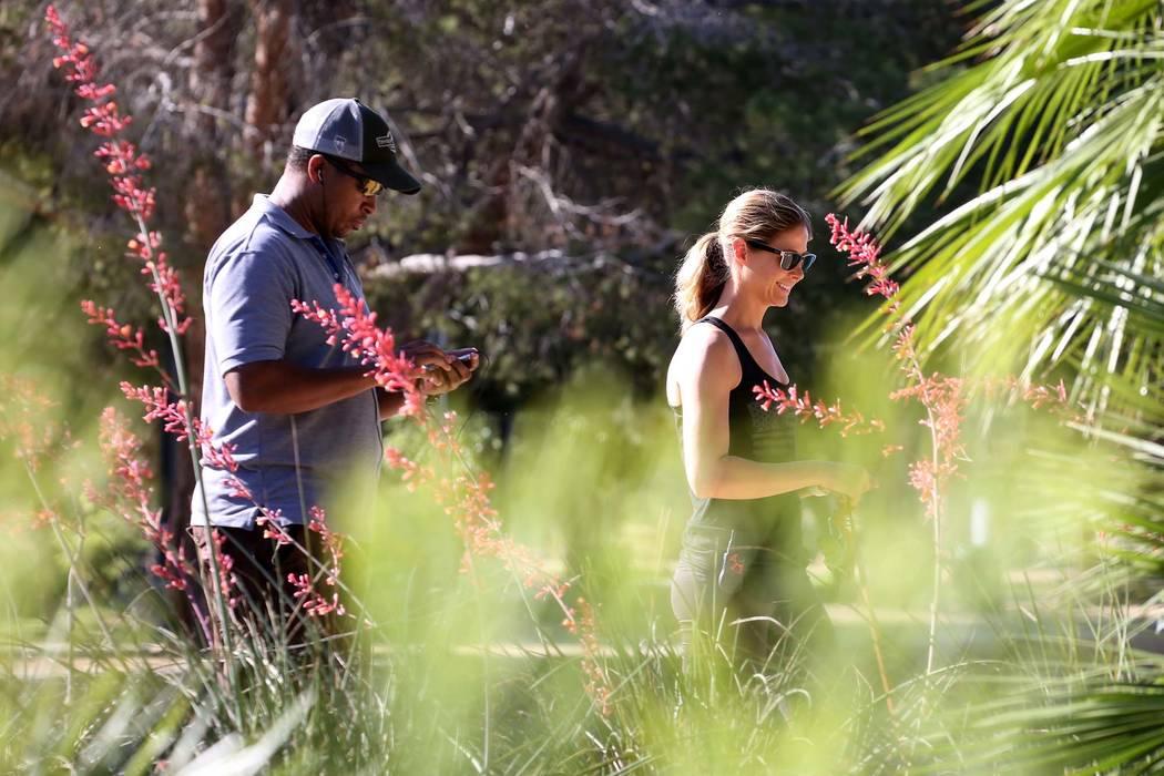 People go for an early morning walk at Sunset Park in Las Vegas. (Bizuayehu Tesfaye/Las Vegas Review-Journal) @bizutesfaye
