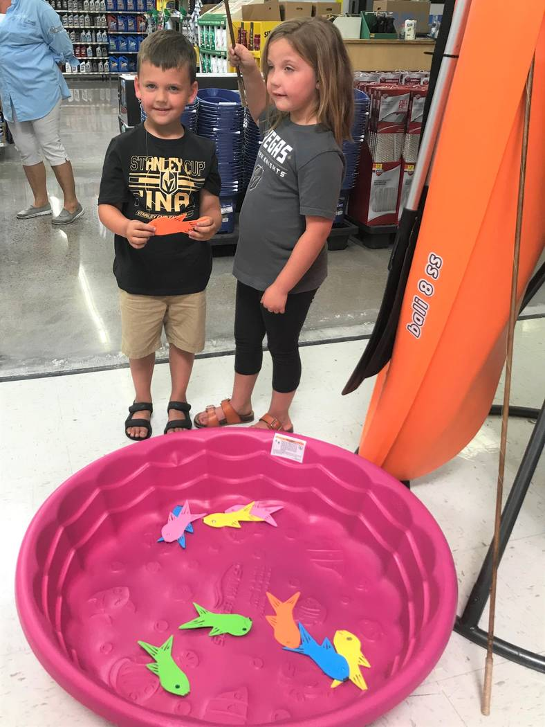 Alex (4) and Haley (6) of Henderson try their fishing skills during a National Fishing and Boating Week event at Walmart in Henderson. The brother and sister tandem caught their limit of orange fi ...