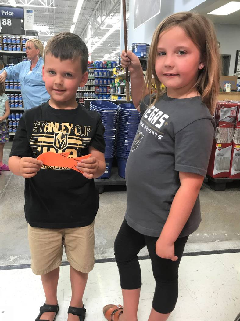 Alex (4) and Haley (6) shared a fishing moment during a National Fishing and Boating Week event at Walmart in Henderson. The brother and sister tandem caught their limit of orange fish. (Doug Nielsen)