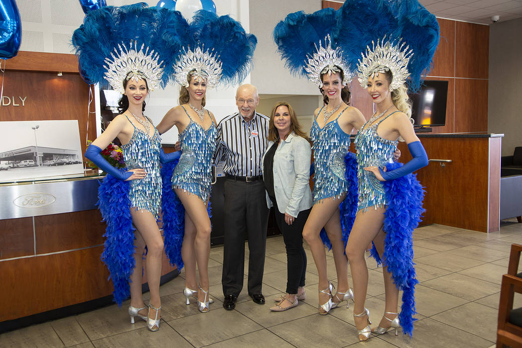 Friendly Ford Friendly Ford owner Ed Olliges and daughter Dana Arcana are seen with showgirls during the dealership's 48th anniversary celebration at 660 N. Decatur Blvd.