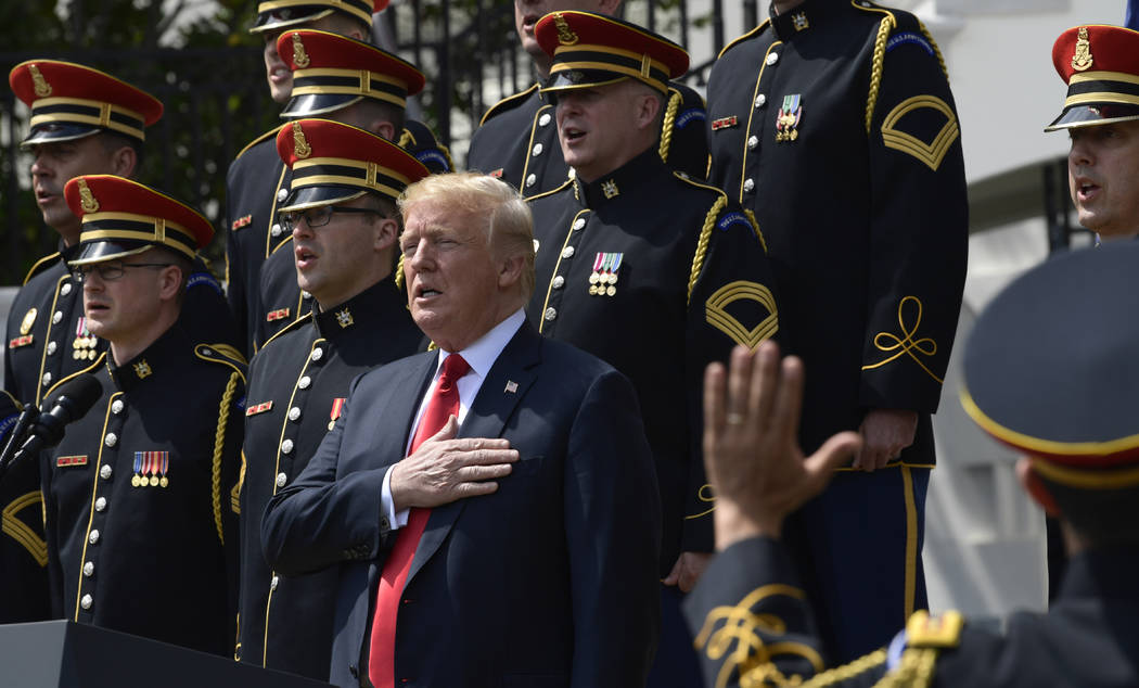 "President Donald Trump sings the National Anthem with the U.S. Army Chorus during a ""Celebration of America"" event at the White House, Tuesday, June 5, 2018, in Washington, in lieu of a ..."