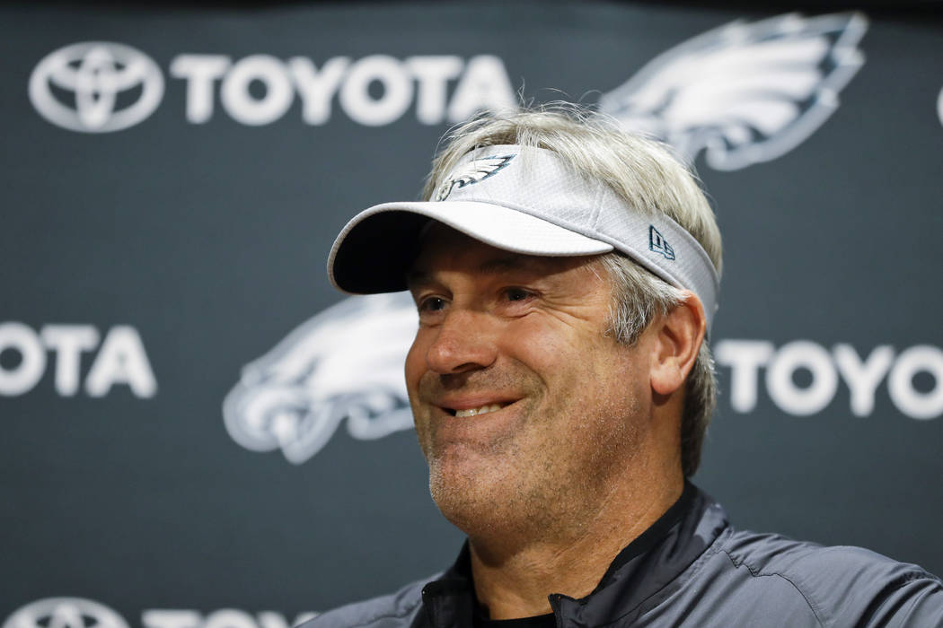 Philadelphia Eagles head coach Doug Pederson smiles while listening to a question from the media during a news conference before practice at the NFL football team's facility, Wednesday, June 6, 20 ...