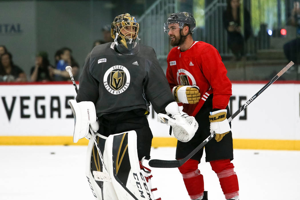 Vegas Golden Knights goaltender Marc-Andre Fleury (29) talks with left wing William Carrier (28) following team practice at City National Arena in Las Vegas on Saturday, May 26, 2018. Richard Bria ...