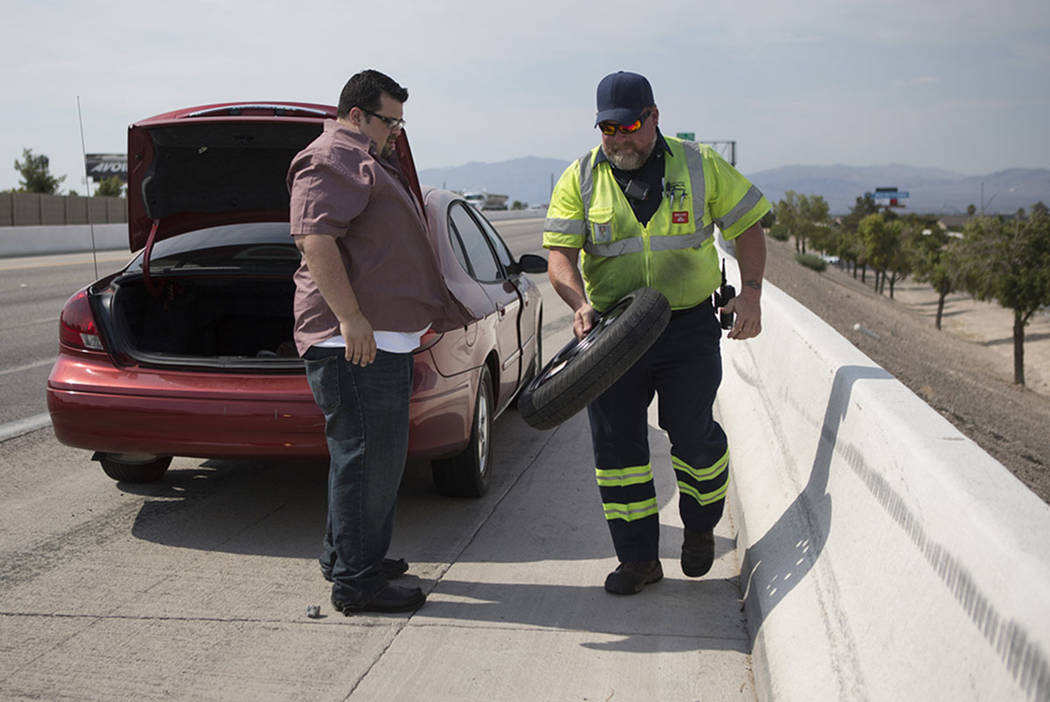 Chuck Gianni, right, technician for the Nevada Department of Transportation service, assists Tom Nobles with a flat tire on U.S. Highway 95 on Tuesday, June 21, 2016, in Las Vegas. (Erik Verduzco/ ...