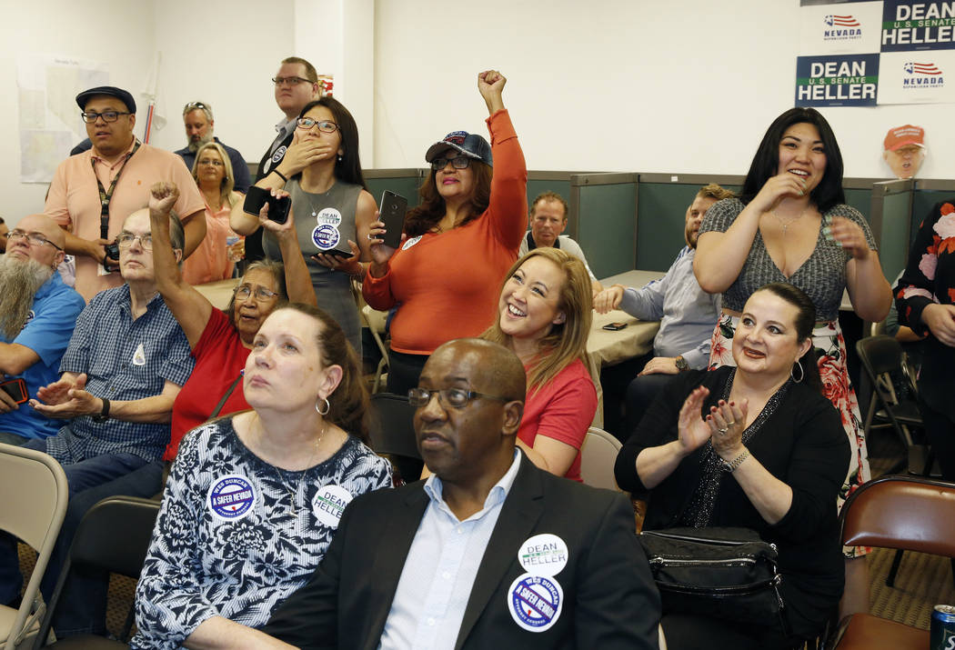 Supporters, including Yan Gun, center, of Henderson and Rose Mary Flores, second right, of Las Vegas react as they watch update election results at a primary election night watch party, hosted by ...