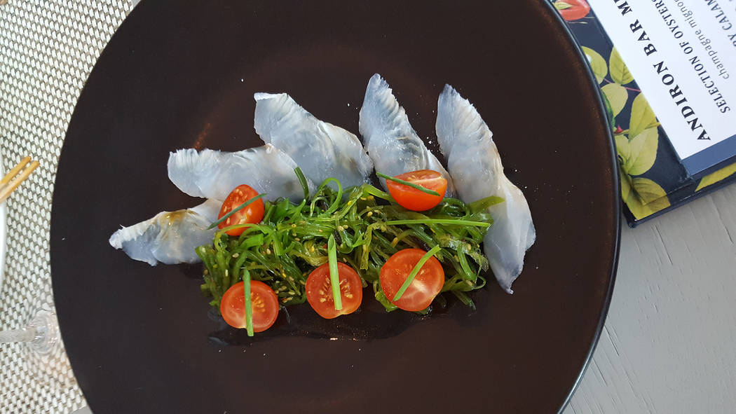 The fluke comes with cherry tomatoes sliced in half and seaweed salad in a lychee vinaigrette at Andiron Steak & Sea, 1720 Festival Plaza Drive. Anne King/View