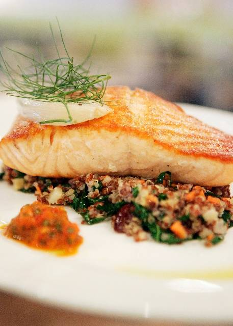 Scottish salmon with quinoa pilaf, braised fennel and house-made peppadew chimichurri is on the menu at Honey Salt.