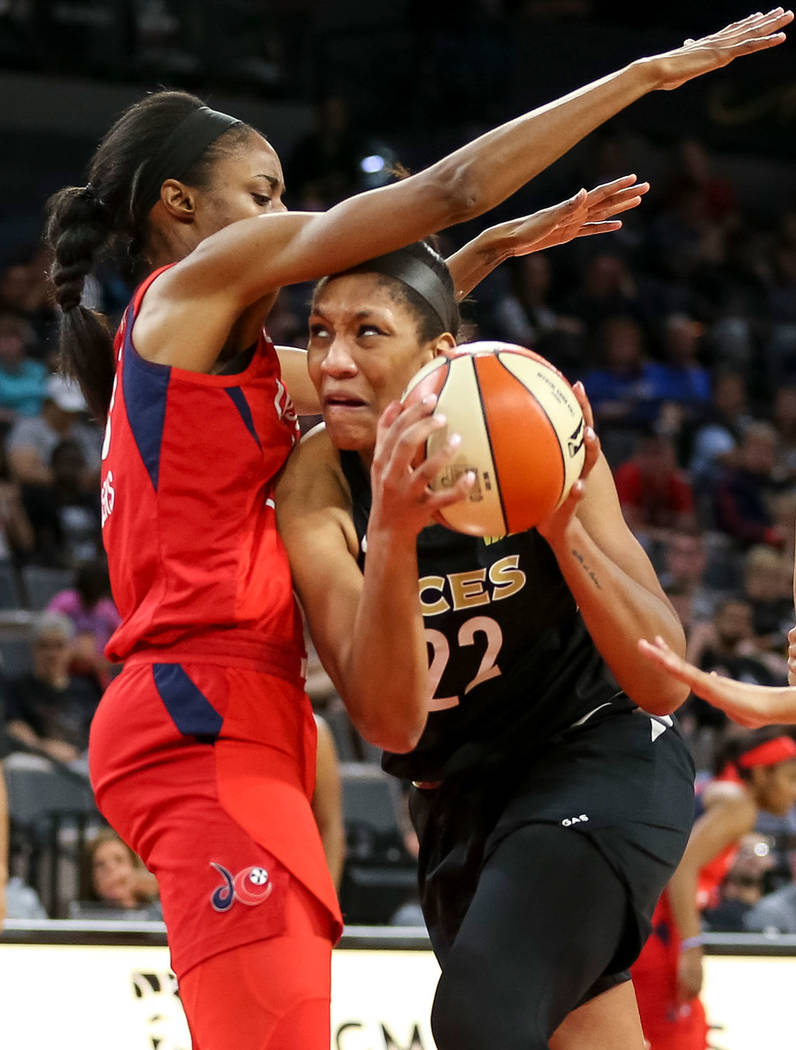 Las Vegas Aces center A'ja Wilson (22) goes to the basket against Washington Mystics forward LaToya Sanders (30) in the second half of a WNBA basketball game at the Mandalay Bay Events Center in L ...
