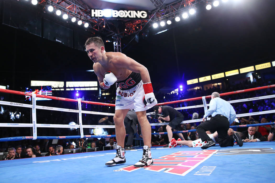 Gennady Golovkin, left, celebrates his knockout win against Vanes Martirosyan in the second round of the WBC and WBA middleweight championship bout at the StubHub Center in Carson, Calif., Saturda ...