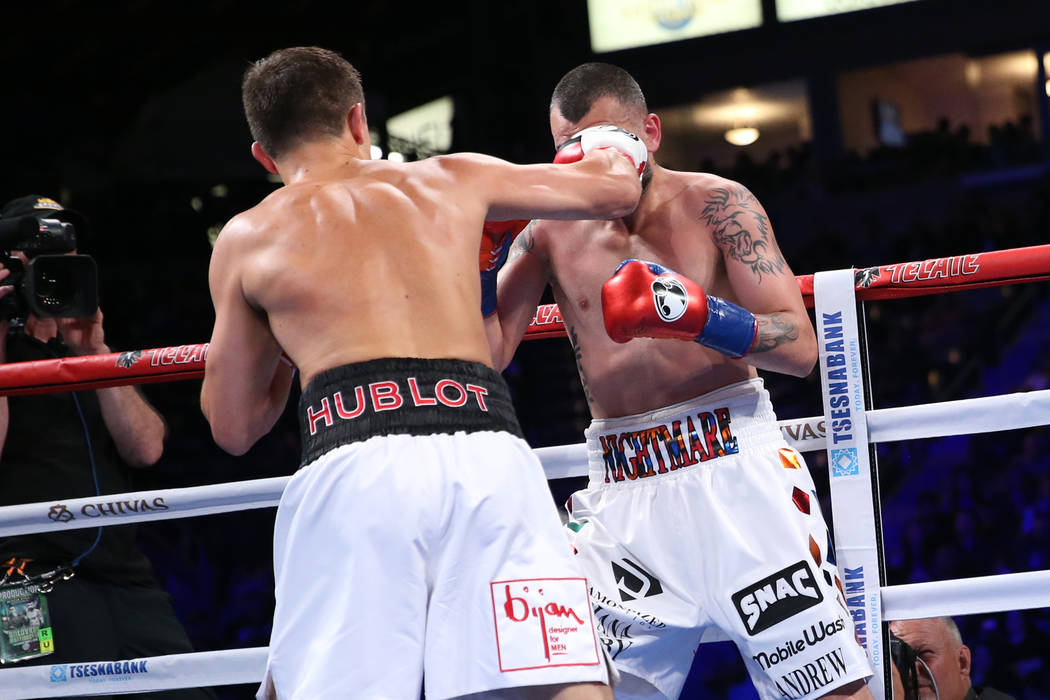 Gennady Golovkin, left, connects a punch against Vanes Martirosyan in the second round of the WBC and WBA middleweight championship bout at the StubHub Center in Carson, Calif., Saturday, May 5, 2 ...