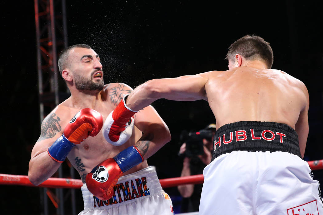 Gennady Golovkin, right, connects a punch against Vanes Martirosyan in the second round of the WBC and WBA middleweight championship bout at the StubHub Center in Carson, Calif., Saturday, May 5, ...