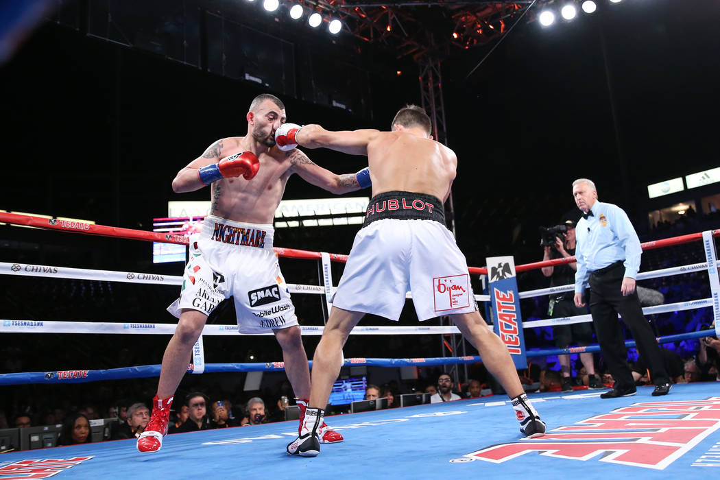 Gennady Golovkin, right, connects a punch against Vanes Martirosyan in the WBC and WBA middleweight championship bout at the StubHub Center in Carson, Calif., Saturday, May 5, 2018. Erik Verduzco ...