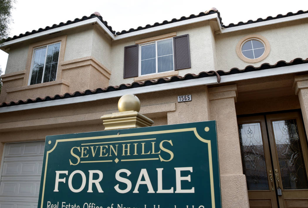 A for sale sign is displayed at a Ravanusa Drive home near Seven Hills Drive in Henderson in 2017. (Bizuayehu Tesfaye Las Vegas Review-Journal)