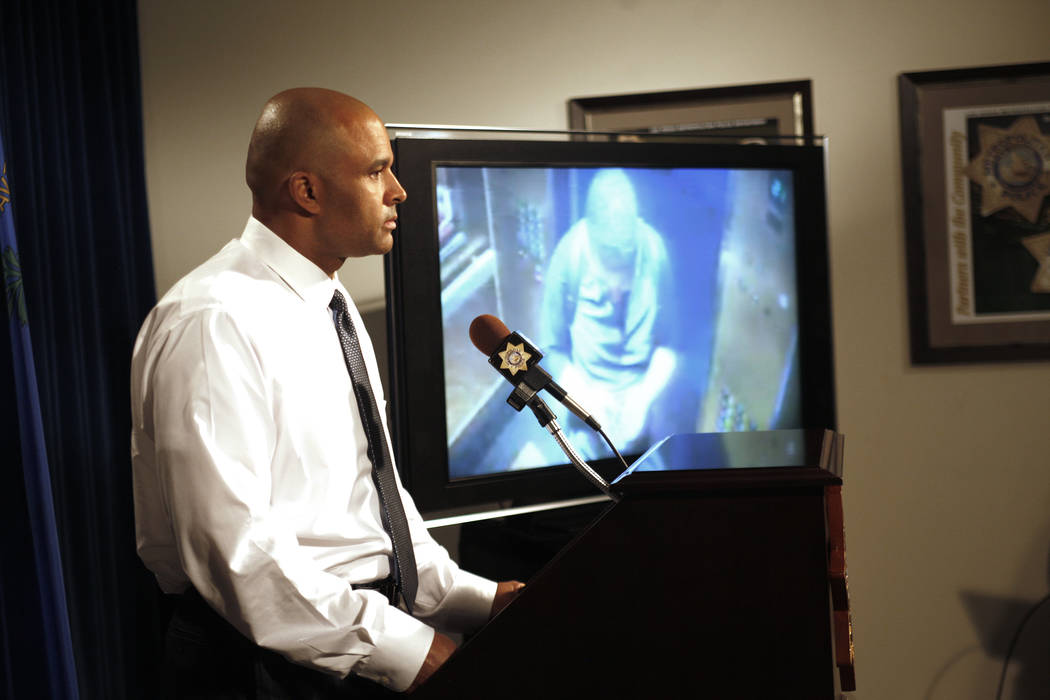 Metropolitan Police Department Lt. Ray Spencer shows the media security footage of the suspect for the double homicide at the Circus Circus hotel-casino at the Las Vegas Metropolitan Police Depart ...