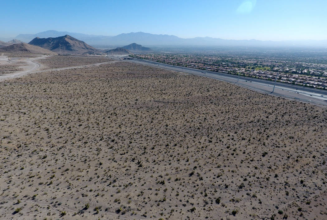 Aerial view of 100 acres of land west of the Summerlin Parkway/215 Beltway interchange offered to Amazon for free as a site to build its second headquarters in Southern Nevada. Wednesday, June 6, ...