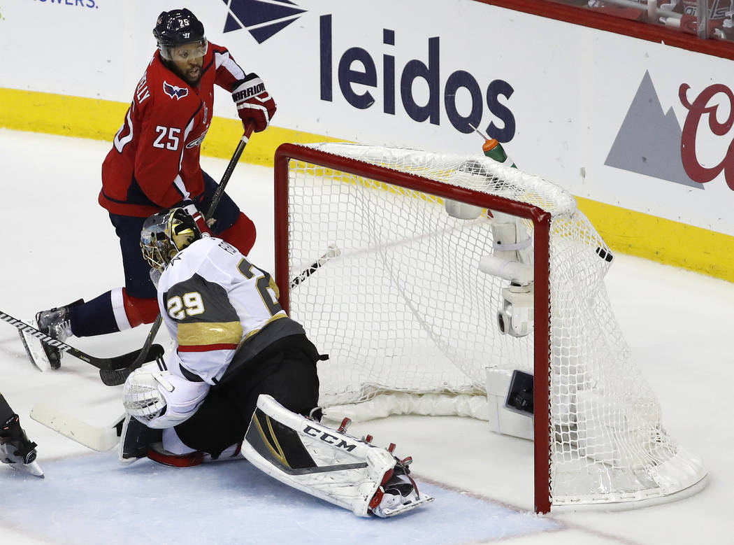Washington Capitals forward Devante Smith-Pelly (25) scores a goal past Vegas Golden Knights goaltender Marc-Andre Fleury (29) during the first period in Game 4 of the NHL hockey Stanley Cup Final ...