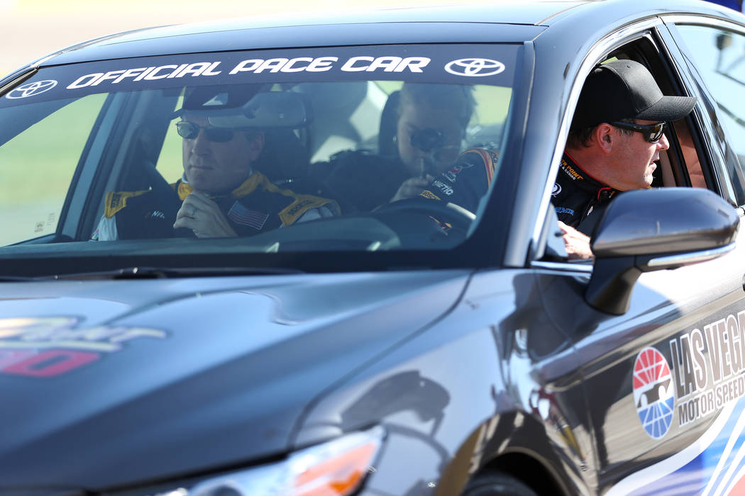 Former hockey star Jeremy Roenick, left, gets ready to drive in a pace car with Nascar driver Brendan Gaughan, at the Las Vegas Motor Speedway in Las Vegas, Wednesday, June 6, 2018. Erik Verduzco ...