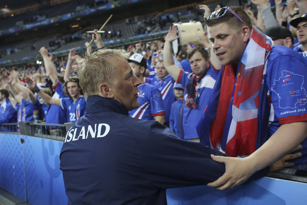 Iceland co-coach Heimir Hallgrimsson salutes supporters at the end of the Euro 2016 quarterfinal soccer match between France and Iceland, at the Stade de France in Saint-Denis, north of Paris, Fra ...