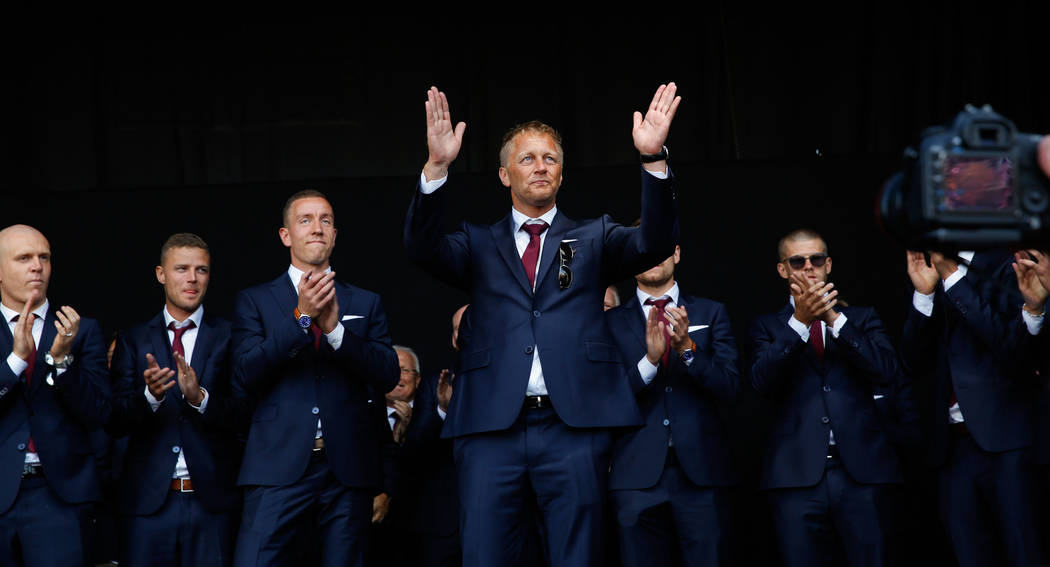 Soccer manager Heimir Hallgrimsson greets the crowd as Icelandic soccer fans welcome their national soccer team home to a hero's welcome from the Euro 2016 soccer championships. (AP Photo/Brynjar ...