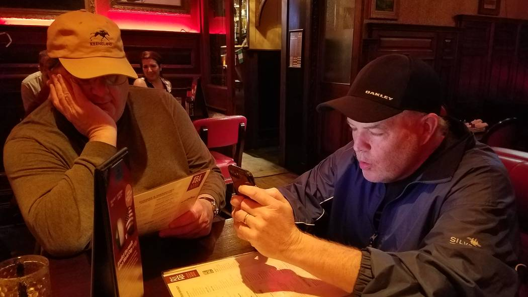 Review-Journal writers Steve Carp, left, Ed Graney check menu and text messages during the Golden Knights' trip to Washington, D.C. (Ron Kantowski)