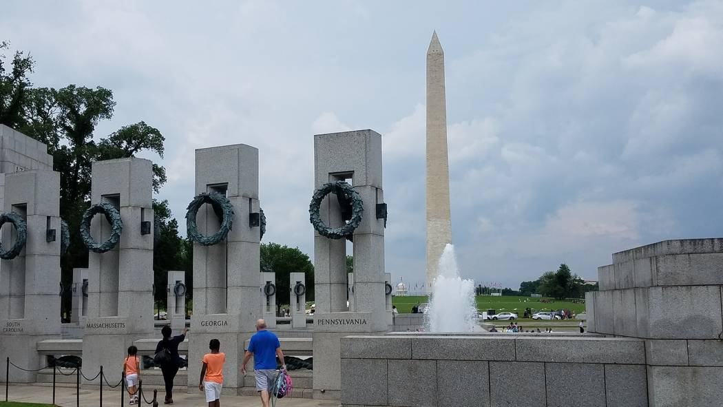 The Washington Monument can be seen in the backdrop of the World War II Memorial adjacent to the National Mall in Washington, D.C. (Ron Kantowski)