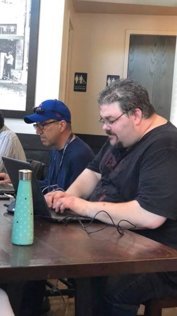 Review-Journal writers Ron Kantowski, left, and Adam Hill work on their stories at a Starbucks coffee shop during the Golden Knights' trip to Washington, D.C. (Ed Graney)