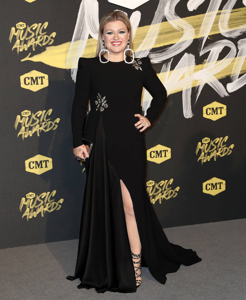 Kelly Clarkson arrives at the CMT Music Awards at the Bridgestone Arena on Wednesday, June 6, 2018, in Nashville, Tenn. (AP Photo/Al Wagner)