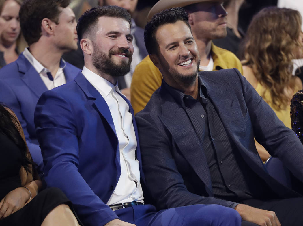 Sam Hunt, left, and Luke Bryan appear in the audience at the CMT Music Awards at the Bridgestone Arena on Wednesday, June 6, 2018, in Nashville, Tenn. (AP Photo/Mark Humphrey)