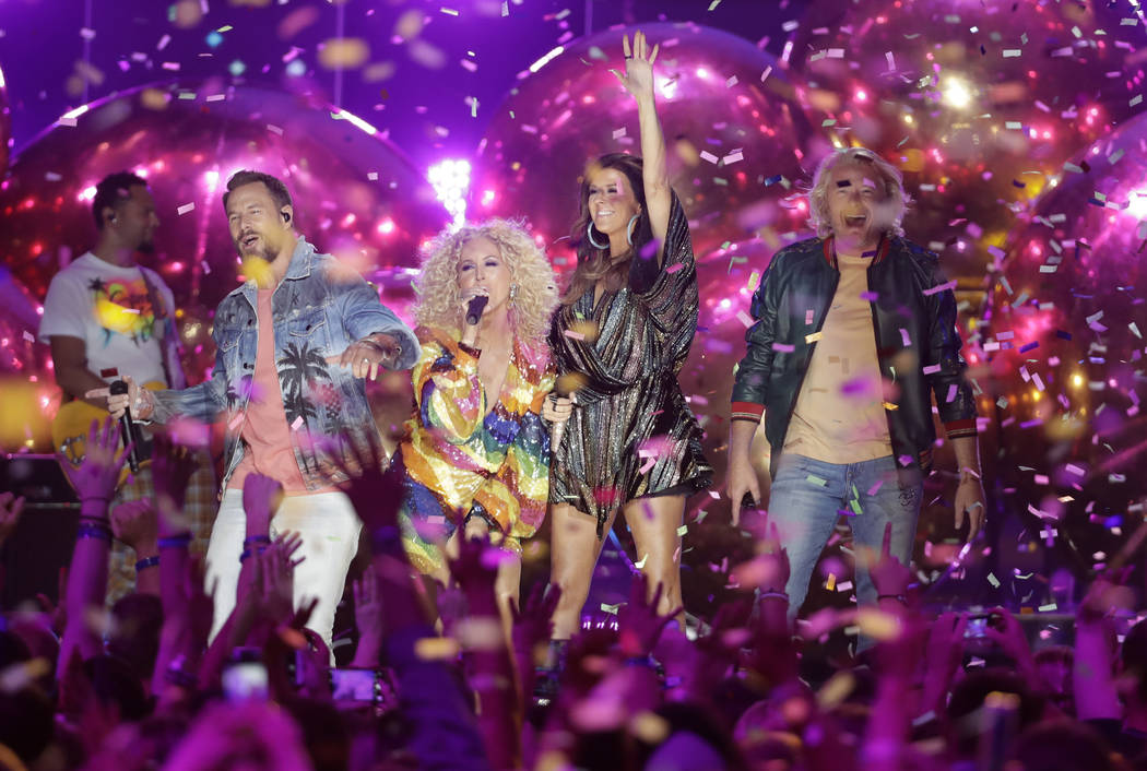 "Jimi Westbrook, from left, Kimberly Schlapman, Karen Fairchild, and Phillip Sweet, of Little Big Town, perform ""Summer Fever"" at the CMT Music Awards at the Bridgestone Arena on Wednesda ..."