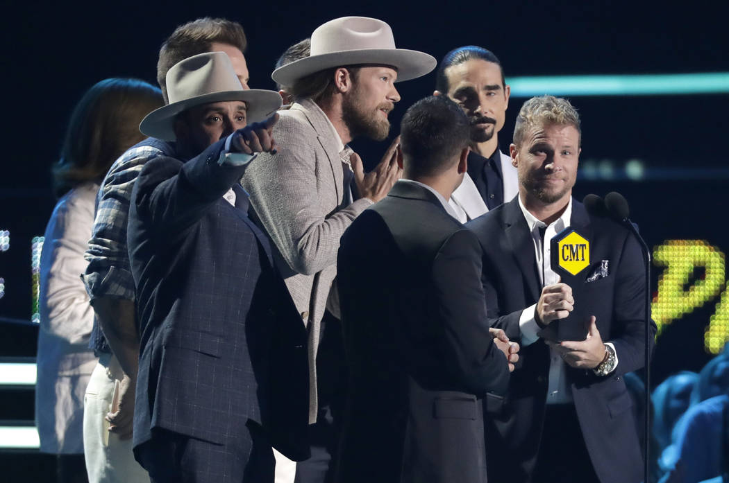Musical groups Backstreet Boys and Florida Georgia Line accept the CMT performance of the year award at the CMT Music Awards at the Bridgestone Arena on Wednesday, June 6, 2018, in Nashville, Tenn ...