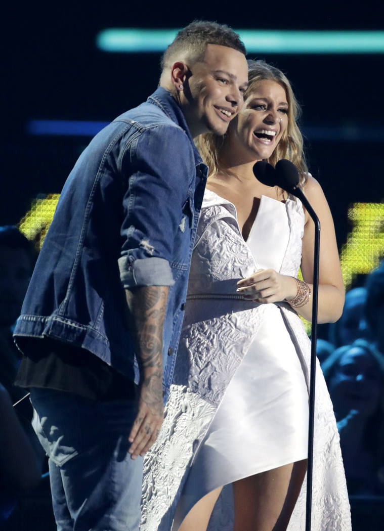 Kane Brown, left, and Lauren Alaina accept the collaborative video of the year award at the CMT Music Awards at the Bridgestone Arena on Wednesday, June 6, 2018, in Nashville, Tenn. (AP Photo/Mark ...