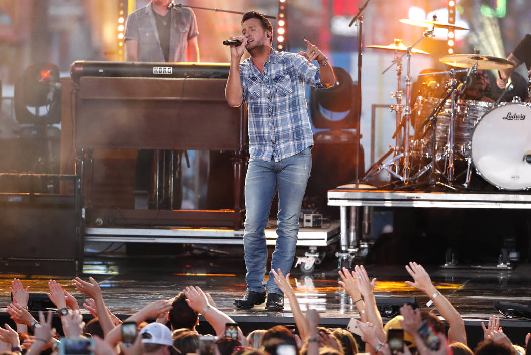 "Luke Bryan performs ""Sunrise, Sunburn, Sunset"" at the CMT Music Awards at the Bridgestone Arena on Wednesday, June 6, 2018, in Nashville, Tenn. (AP Photo/Al Wagner)"
