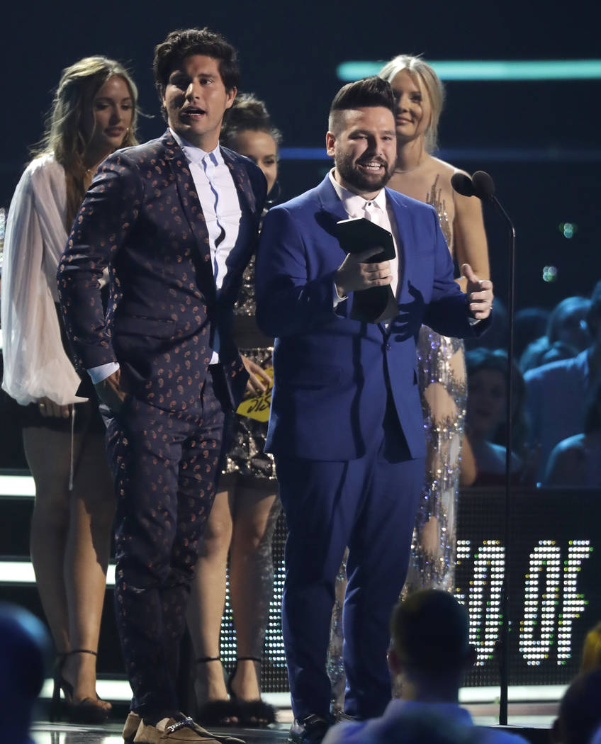 "Dan Smyers, left, and Shay Mooney of musical group Dan + Shay accept the duo video of the year award for ""Tequila"" at the CMT Music Awards at the Bridgestone Arena on Wednesday, June 6, ..."