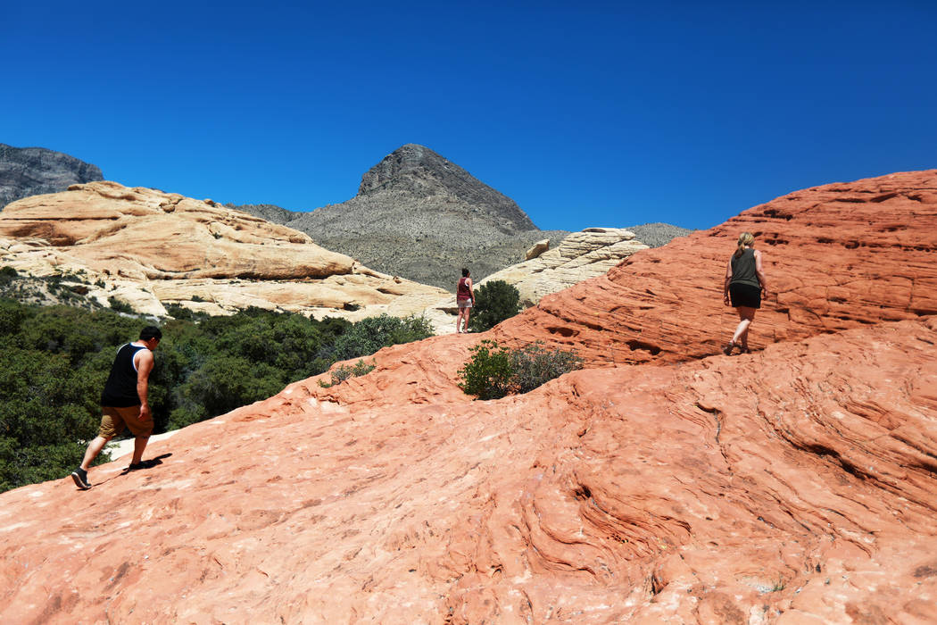 Visitors walk around Red Rock Canyon National Conservation Area in Las Vegas on Monday, May 7, 2018. (Andrea Cornejo/Las Vegas Review-Journal) @dreacornejo