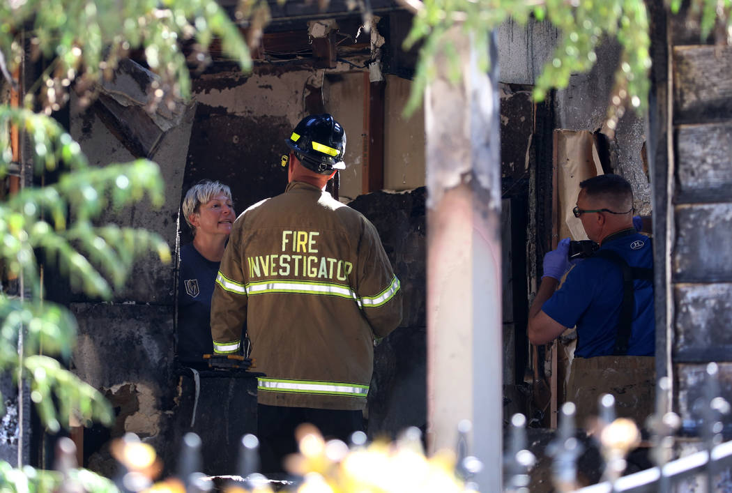 Clark County firefighters investigate the cause of a house fire at 5064 San Anselmo St., on Thursday, June 7, 2018, in Las Vegas. Bizuayehu Tesfaye/Las Vegas Review-Journal @bizutesfaye