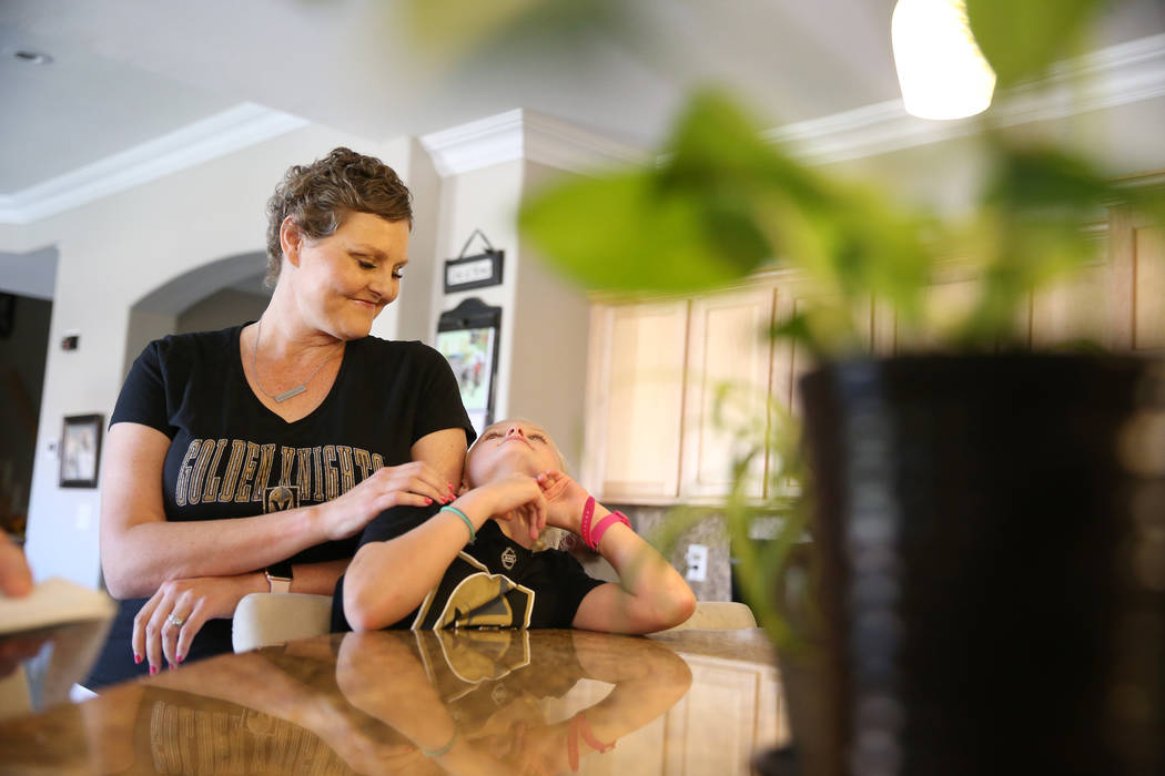 Stacy Perry with her daughter Cali, 8, at their Las Vegas home, Thursday, June 7, 2018. Stacy is undergoing treatment for her stage 4 colon cancer. Erik Verduzco Las Vegas Review-Journal @Erik_Ver ...