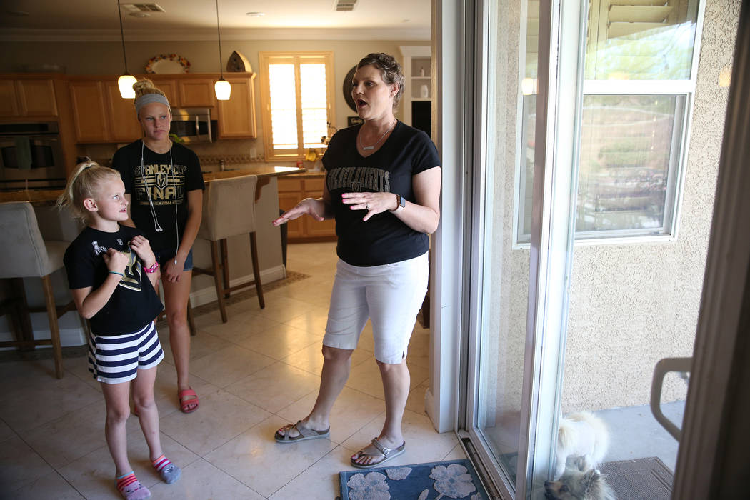 Stacy Perry with her daughters Cali, 8, left, Bryanna, 13, and at their Las Vegas home, Thursday, June 7, 2018. Stacy is undergoing treatment for her stage 4 colon cancer. Erik Verduzco Las Vegas ...